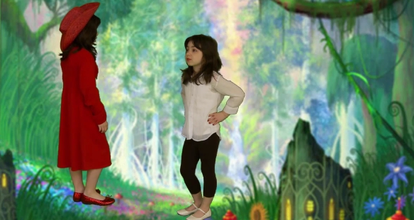 A girl in a red dress is talking to another girl
