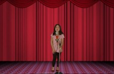 Girl is singing on stage