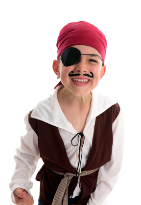 Boy acting in a pirate custom